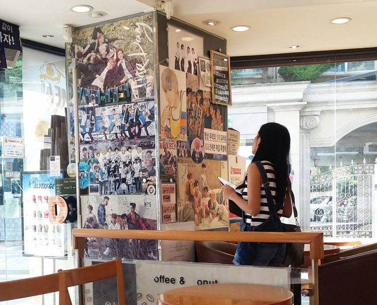 Karen Meets World while looking at JYP artists posters inside Dunkin Donuts